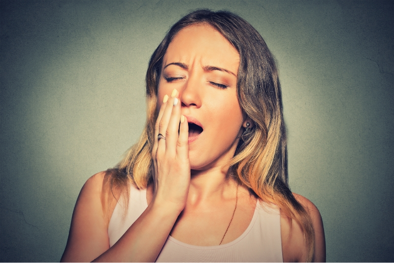 Woman yawning who is tired from Sleep Apnea
